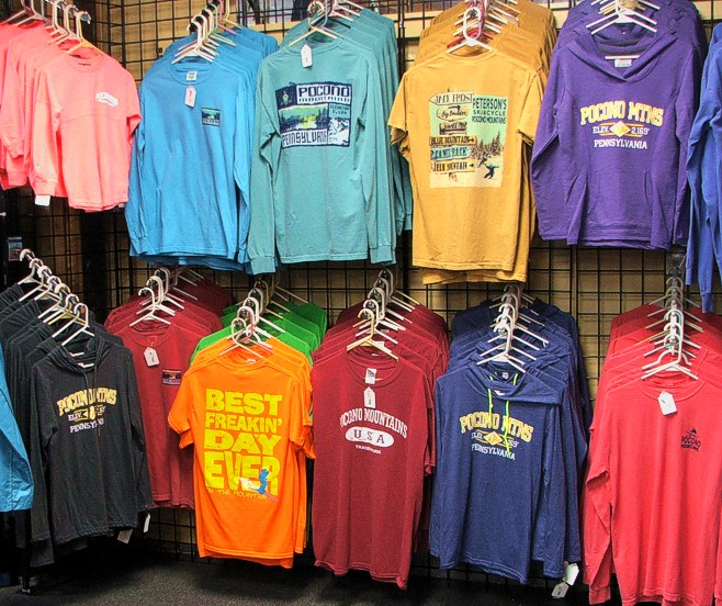 Pocono Souvenir Tee Shirts on Wall
